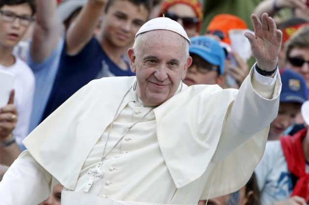 Pope Francis waves as he arrives to attend an audience for altar servers at St. Peter's Square in Vatican City